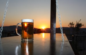 Enjoy your drink at the Rooftop Bar of Pella Inn watching the sunset.